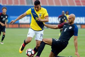 John Brooks tackles Angel Mena in USA's friendly vs. Ecuador