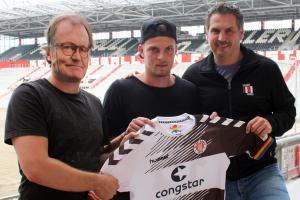 German soccer team has masked man pose as manager