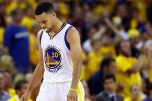 Stephen Curry reacts to Warriors NBA Finals loss