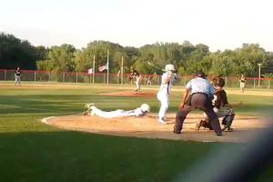 Player steals home through teammate's legs