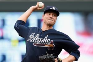 Braves trade pitcher Lucas Harrell to Rangers