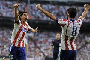 Tiago Mendes of Atletico de Madrid celebrates after scoring his team's opening goal against Real.