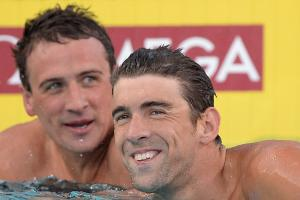 Ryan Lochte (left) always seems to have to share the spotlight with Michael Phelps, even when finishing ahead in the pool.