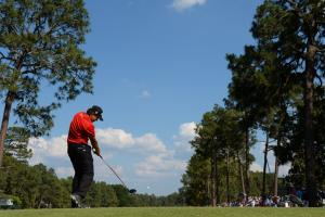 Erik Compton tees off during the fourth round of the U.S. Open at Pinehurst Resort and Country Club.