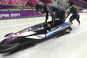 Speedy Williams, U.S. women's bobsled in position for g...