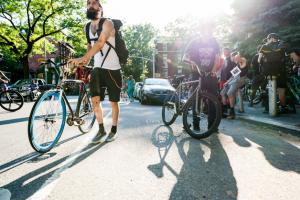 Competitors fill the streets outside the Brooklyn Masonic Temple as they get ready for racing at Red Bull Mini Drome in Brooklyn, NY.