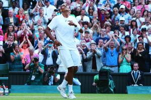 Nick Kyrgios celebrates after winning match point against Rafael Nadal in the fourth round of Wimbledon.