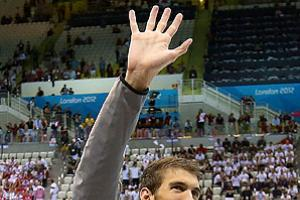 Michael Phelps waves goodbye at the end of his storied Olympic swimming career.