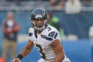 Seattle's Russell Wilson propelled many fantasy owners to the finals after running for three scores and throwing for another versus the Bills.