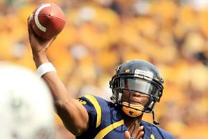 Geno Smith's signature performance came in Week 4, when he threw for 8 TDs against Baylor in a 70-63 win.