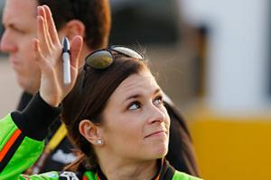 Danica Patrick said a winter spent with her family has helped her find happiness despite an impending divorce.
