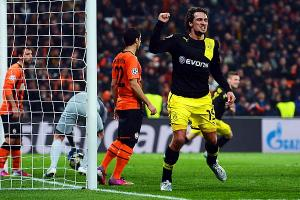 Mats Hummels celebrates his 87th-minute goal for Dortmund, one of three German clubs in the last 16.
