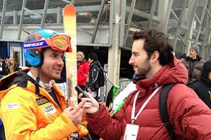 NBC Olympic researcher Alex Goldberger interviews Canadian skier Jan Hudec at the alpine skiing world championships.