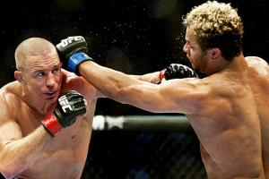Georges St.-Pierre (left) will be seeking his eighth straight successful title defense in UFC 158.