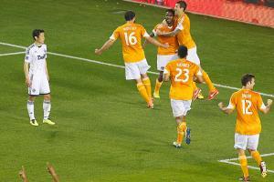 Dynamo defender Warren Creavalle celebrates his game-winning goal against the Vancouver Whitecaps.