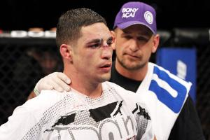 Greg Jackson (right) consoles his defeated fighter Diego Sanchez in February 2012.