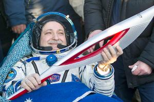 Sochi Olympic torch returns from International Space St...