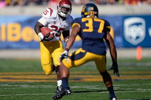 Silas Redd (25) ran for 1,281 yards and 10 TDs in two years after transferring to USC from Penn State.