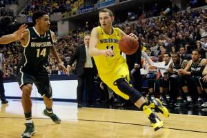 Michigan guard Nik Stauskas, right, has had his draft stock rise considerably after starring for the Wolverines this season.