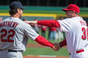Cardinals manager Mike Matheny and Reds boss Bryan Price greet one another before the season opener.