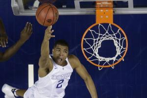 Kentucky guard Aaron Harrison (2) shoots against Arkansas forward Bobby Portis (10) during the second half of the NCAA college basketball Southeastern Conference tournament championship game, Sunday, March 15, 2015, in Nashville, Tenn. Kentucky won 78-63.