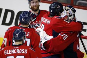 Washington Capitals left wing Alex Ovechkin (8), from Russia, embraces goalie Braden Holtby (70) after  Game 3 in the second round of the NHL Stanley Cup hockey playoffs against the New York Rangers, Monday, May 4, 2015, in Washington. The Capitals won 1-