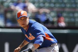 New York Mets shortstop Wilmer Flores (4) prepares to field a fielder's choice by Texas Rangers' Adam Rosales in the fourth inning of an exhibition baseball game, Saturday April 4, 2015, in Arlington, Texas. Rosales was safe at first. (AP Photo/Tony Gutie