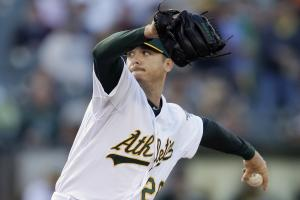 FILE - In this June 19, 2014, file photo, Oakland Athletics' Scott Kazmir works against the Boston Red Sox in the first inning of a baseball game in Oakland, Calif. The Athletics have begun their expected changes leading up to the trade deadline, sending