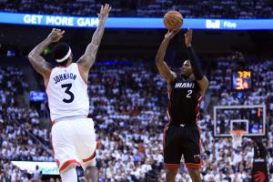 TORONTO, ON - MAY 05:  Joe Johnson #2 of the Miami Heat shoots the ball as James Johnson #3 of the Toronto Raptors defends in the second half of Game Two of the Eastern Conference Semifinals during the 2016 NBA Playoffs at the Air Canada Centre on May 5,