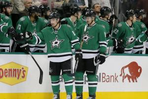 FILE - In this Jan. 25, 2016, file photo, Dallas Stars' Patrick Sharp (10) and Jason Spezza (90) are congratulated by the bench after Spezza scored a goal against the Calgary Flames in the second period of an NHL hockey game in Dallas. Known as the North