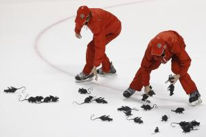 FILE - In this Friday, April 15, 2016, crews round up rats thrown on the ice by fans after Florida Panthers defenseman Dmitry Kulikov scored an empty-net goal during the third period of Game 2 in a first-round NHL hockey Stanley Cup playoff series against