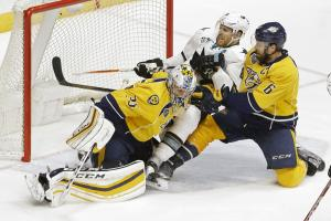 San Jose Sharks center Joe Pavelski (8) and Nashville Predators defenseman Shea Weber (6) slide into Predators goalie Pekka Rinne (35), of Finland, during the second overtime period in Game 4 of an NHL hockey Stanley Cup Western Conference semifinal playo