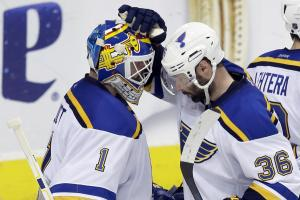 St. Louis Blues goalie Brian Elliott (1) and Troy Brouwer (36) congratulate each other after Game 5 of the NHL hockey Stanley Cup Western Conference semifinals against the Dallas Stars Saturday, May 7, 2016, in Dallas. The Blues won 4-1. (AP Photo/LM Oter