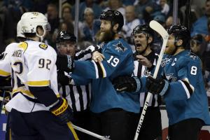 Nashville Predators' Ryan Johansen (92) gets into a shoving match with San Jose Sharks' Joe Thornton (19) during the third period of Game 5 in an NHL hockey Stanley Cup Western Conference semifinal series Saturday, May 7, 2016, in San Jose, Calif. San Jos