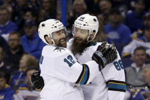 San Jose Sharks defenseman Brent Burns (88) with center Patrick Marleau (12) after scoring a goal during the third period in Game 2 of the NHL hockey Stanley Cup Western Conference finals against the St. Louis Blues, Tuesday, May 17, 2016, in St. Louis. (