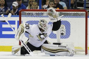 Pittsburgh Penguins goalie Matt Murray (30) makes a glove save on a shot by the Tampa Bay Lightning during the third period of Game 3 of the NHL hockey Stanley Cup Eastern Conference Finals Wednesday, May 18, 2016, in Tampa, Fla. The Penguins won the game