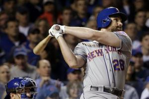 FILE - In this Oct. 20, 2015, file photo, New York Mets' Daniel Murphy (28) hits a home run during the third inning of Game 3 of the National League baseball championship series against the Chicago Cubs in Chicago. Murphy is among the top players to join