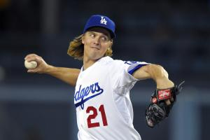 FILE - In this Sept. 18, 2015, file photo, Los Angeles Dodgers starting pitcher Zack Greinke throws to the plate during the first inning of a baseball game against the Pittsburgh Pirates in Los Angeles. Greinke is among the top players to join the NL West