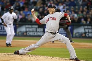 Boston Red Sox starting pitcher Clay Buchholz delivers during the first inning of a baseball game against the Chicago White Sox Wednesday, May 4, 2016, in Chicago. (AP Photo/Charles Rex Arbogast)