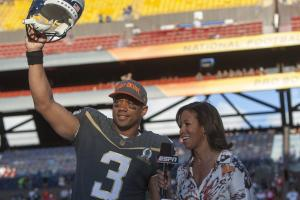 Seattle Seahawks quarterback Russell Wilson (3) of Team Irvin reacts after winning offensive MVP award while being interviewed by ESPN sideline reporter Lisa Salters at the NFL Pro Bowl football game Sunday, Jan. 31, 2016, in Honolulu. Team Irving beat Te