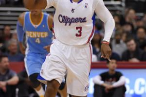 Los Angeles Clippers guard Chris Paul gestures after scoring during the second half of an NBA basketball game against the Denver Nuggets, Tuesday, April 15, 2014, in Los Angeles. The Clippers won the game 117-105. (AP Photo/Mark J. Terrill)