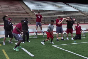 Troy Trojans coaching staff dances very awkwardly in vi...
