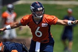 Who will Broncos start at quarterback?