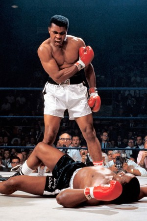 In one of the most iconic and controversial moments of his career, Ali stands over Sonny Liston and yells at him after knocking the former champ down in the first round of their 1965 rematch. Skeptics dubbed it