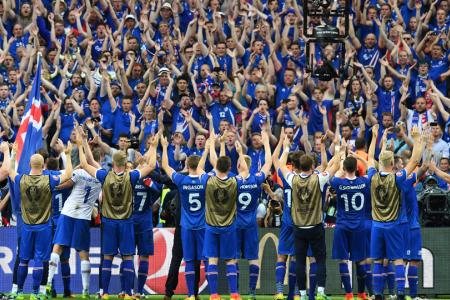 Iceland celebrates with its fans after beating Austria at Euro 2016