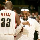 2009 - The Shaqtus approves of LeBron's forehead exposure. (David Liam/Getty Images)