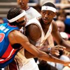 2004 - In his rookie year, LeBron makes the jump to a thicker headband. (Tony Dejak/AP)