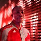 Dwight Howard models the Rockets' new warm-up jacket. (Adidas)