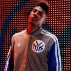 Iman Shumpert models the Knicks' new varsity jacket. (Adidas)
