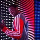 John Wall models the Wizards' new varsity jacket. (Adidas)